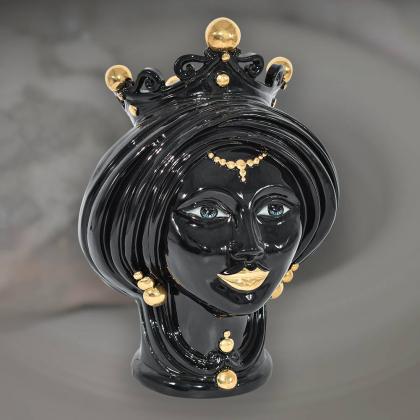 Testa di moro moderna in nero con oro zecchino